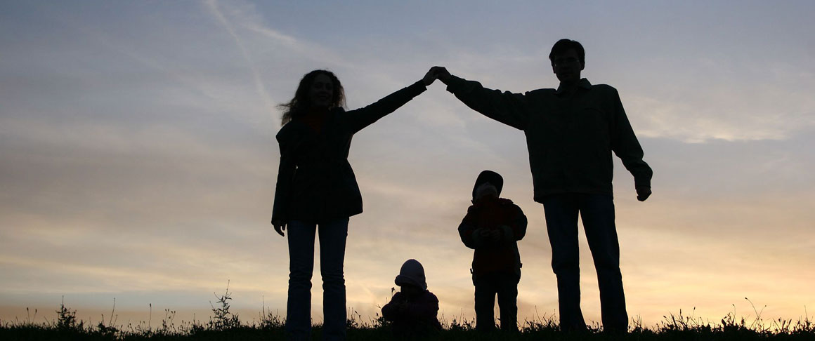 A silhouette of a family with two children